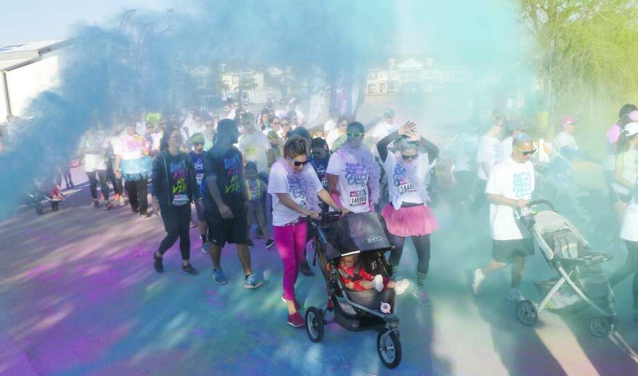 Participants in the Color Vibe 5K run through plumes of color powder 03-18-17 at the Scharbauer Sports Complex at the start of the color run benefiting Boys and Girls Club of Midland. Tim Fischer/Reporter-Telegram Photo: Tim Fischer/Midland Reporter-Telegram