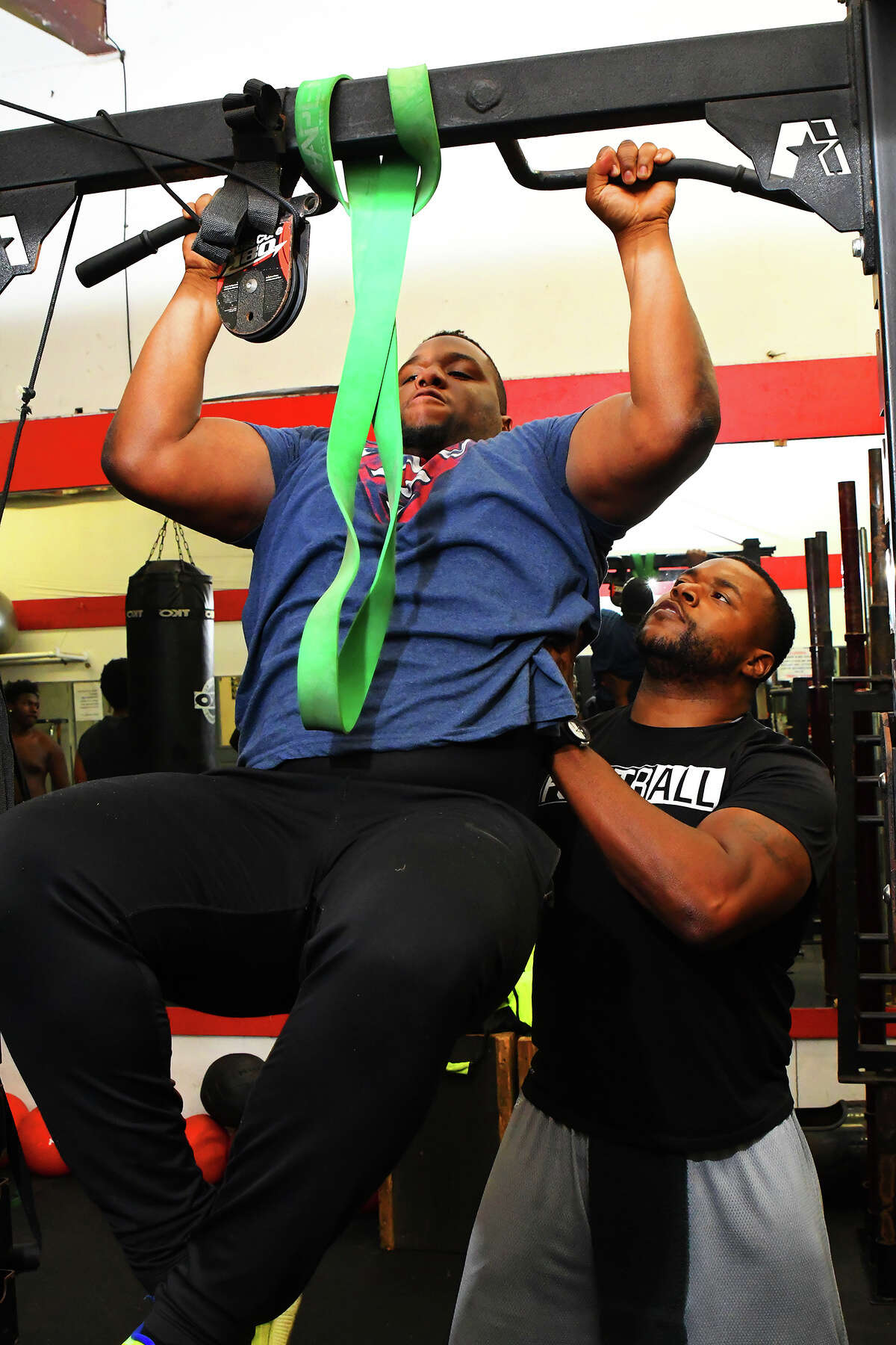 Cy-Fair defensive lineman Hunter Adams works out with Larry Brown. Adams credits Brown, along with Cy-Fair Head Coach Ed Pustejovsky, with preparing him for competing at the next level. Adams will be playing for West Point next year, with an eye towards competing in the NFL.