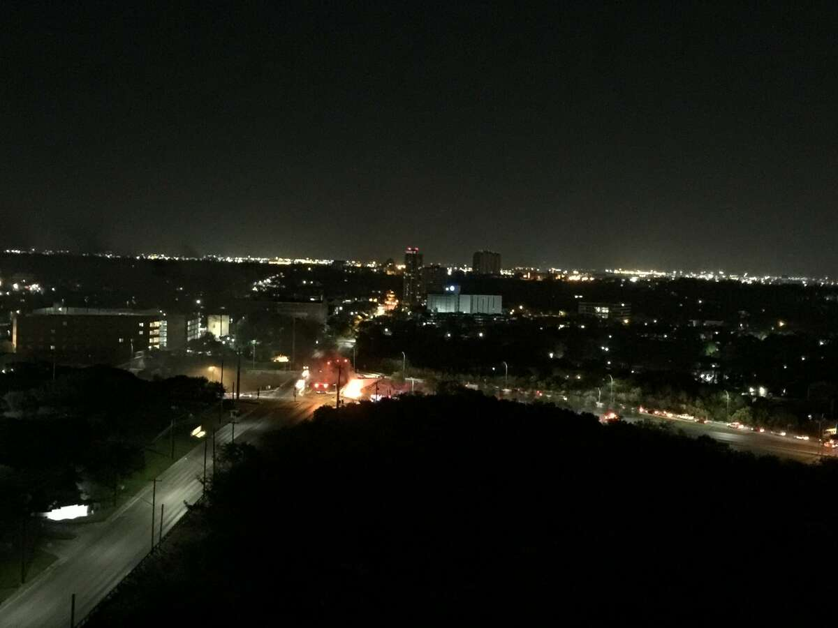 A driver was killed early Saturday, March 18, 2017, after their car slammed into a wall and erupted in flames on Hwy. 281 near Hildebrand. A reader-submitted photo shows a view of the crash from Olmos Tower.