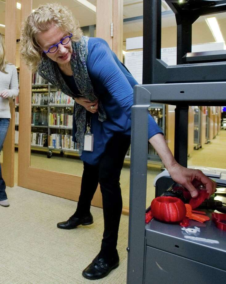 Dorothy Pawlowski, head of Adult Services, picks out some items created on a 3D printer in the Donofrio Technology Center at the Ridgefield Library. Saturday, March 18, 2017 Photo: SCOTT MULLIN / Scott Mullin ownership