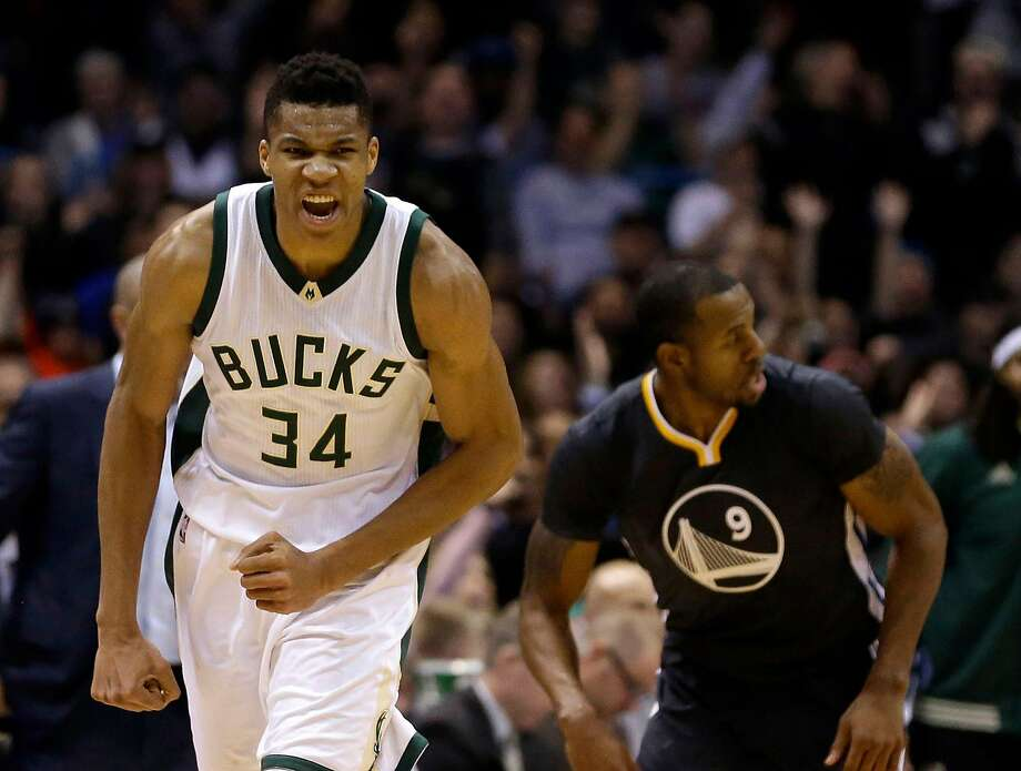 Milwaukee Bucks' Giannis Antetokounmpo (34) reacts after a made shot during the first half of an NBA basketball game against the Golden State Warriors Saturday, Dec. 12, 2015, in Milwaukee. (AP Photo/Aaron Gash) Photo: Aaron Gash, Associated Press