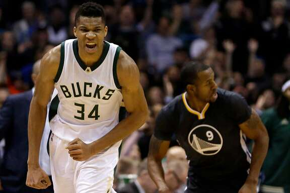 Milwaukee Bucks' Giannis Antetokounmpo (34) reacts after a made shot during the first half of an NBA basketball game against the Golden State Warriors Saturday, Dec. 12, 2015, in Milwaukee. (AP Photo/Aaron Gash)