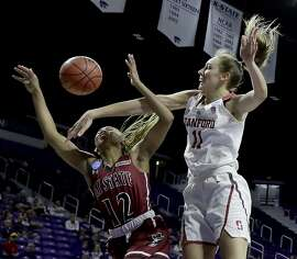 Stanford's Alana Smith (11) blocks a shot by New Mexico State's Zaire Williams (12) during the first half of a first-round game in the NCAA women's college basketball tournament Saturday, March 18, 2017, in Manhattan, Kan. (AP Photo/Charlie Riedel)