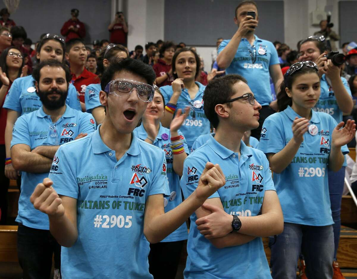 Seyhmus Aca (left) watches his Sultans of Turkey teammates compete in a qualifying match of the FIRST robotics competition at St. Ignatius College Prep in San Francisco, Calif. on Saturday, March 18, 2017. Forty-one schools and organizations, including three from Turkey, entered robots in the event.