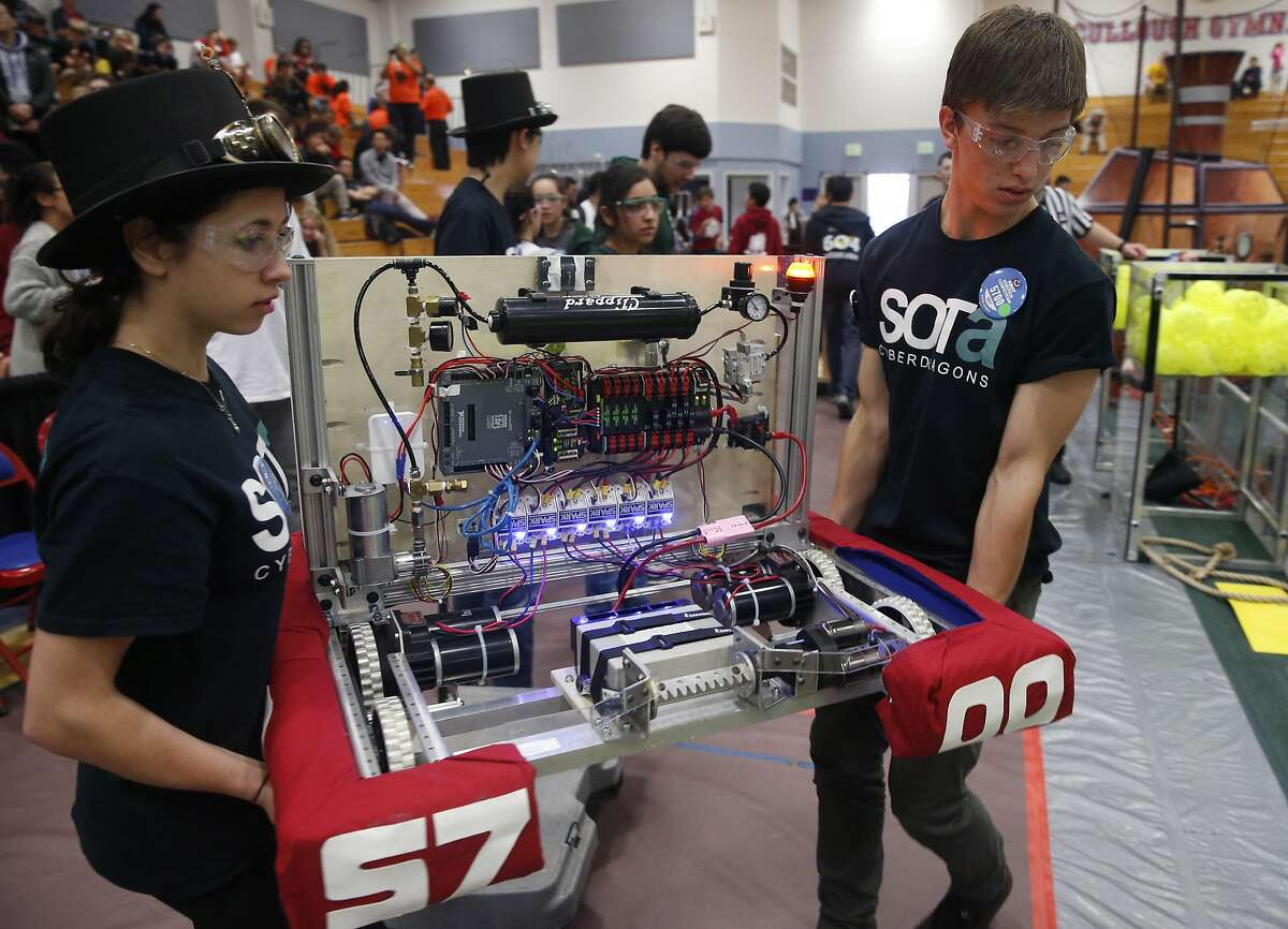 Members of the Ruth Asawa School of the Arts Cyberdragons carry their robot into the arena for a qualifying match in the FIRST robotics competition at St. Ignatius College Prep in San Francisco, Calif. on Saturday, March 18, 2017. Forty-one schools and organizations, including three from Turkey, entered robots in the event.