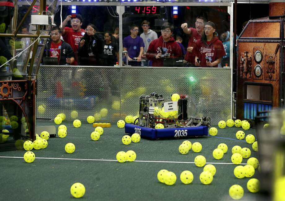 Robotics teams square off in a qualifying match of the First Robotics Competition at St. Ignatius College Prep in San Francisco, where 41 schools competed. Photo: Paul Chinn, The Chronicle