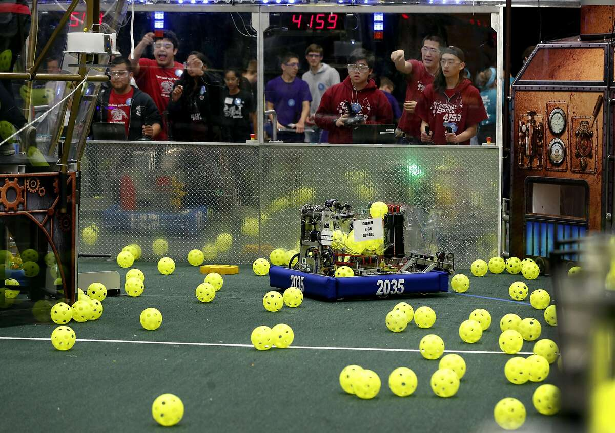 Robotics teams square off in a qualifying match of the FIRST robotics competition at St. Ignatius College Prep in San Francisco, Calif. on Saturday, March 18, 2017. Forty-one schools and organizations, including three from Turkey, entered robots in the event.