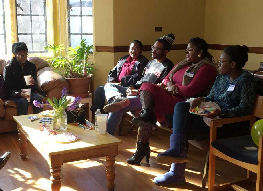 Members of the Community of Love Christian Fellowship in Boston meet once a month for a conversation hour.  Photo: Julie Zauzmer / The Washington Post