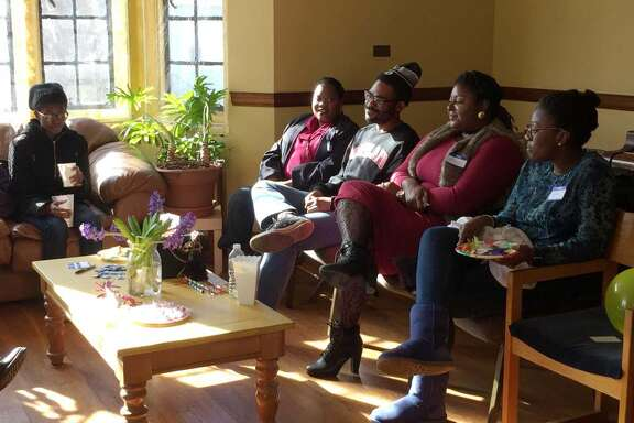 Members of the Community of Love Christian Fellowship in Boston meet once a month for a conversation hour.