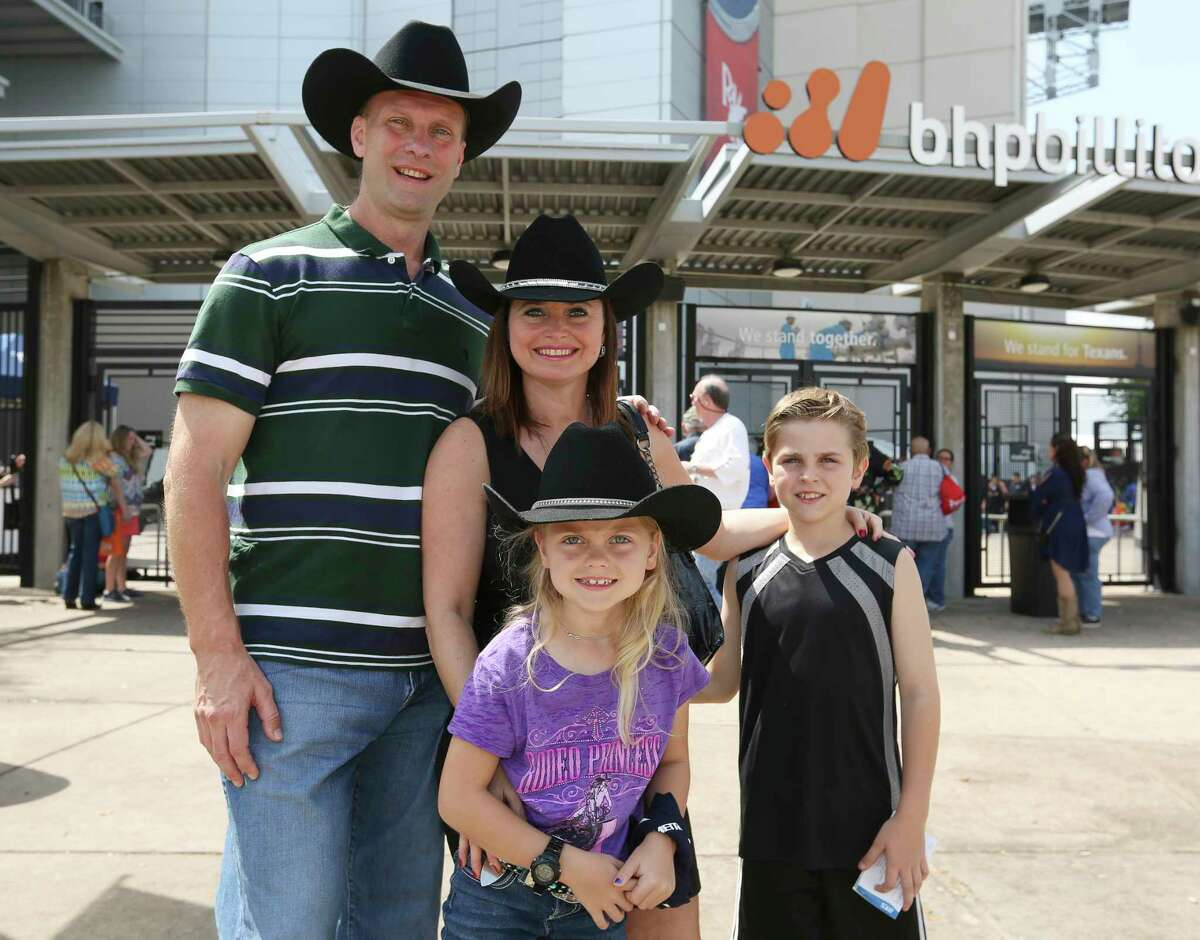 Houston Livestock Show & Rodeo and Willie Nelson fans pose for a photograph at NRG Stadium before the show Saturday, March 18, 2017, in Houston.