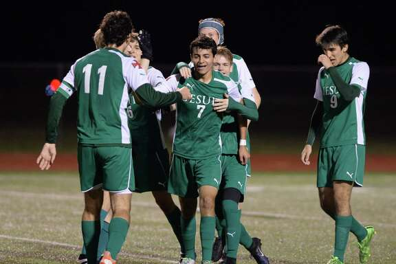 Jesuit players celebrate a goal made by mid-fielder Chris Sammour (7) during the second half of District 19-6A boys soccer game between the Cinco Ranch Cougars and the Strake Jesuit Crusaders on Friday February 17, 2017 at Cinco Ranch HS, Katy, TX.