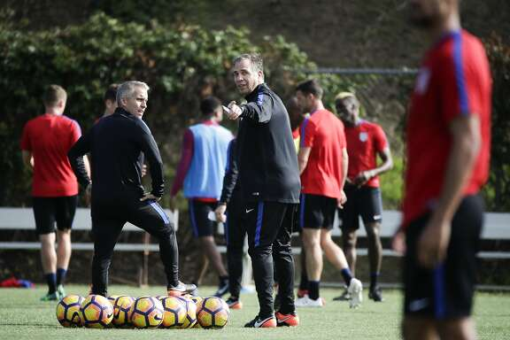U.S. men's national soccer team coach Bruce Arena, center, gestures during a practice session Wednesday, Jan. 11, 2017, in Carson, Calif. (AP Photo/Jae C. Hong)