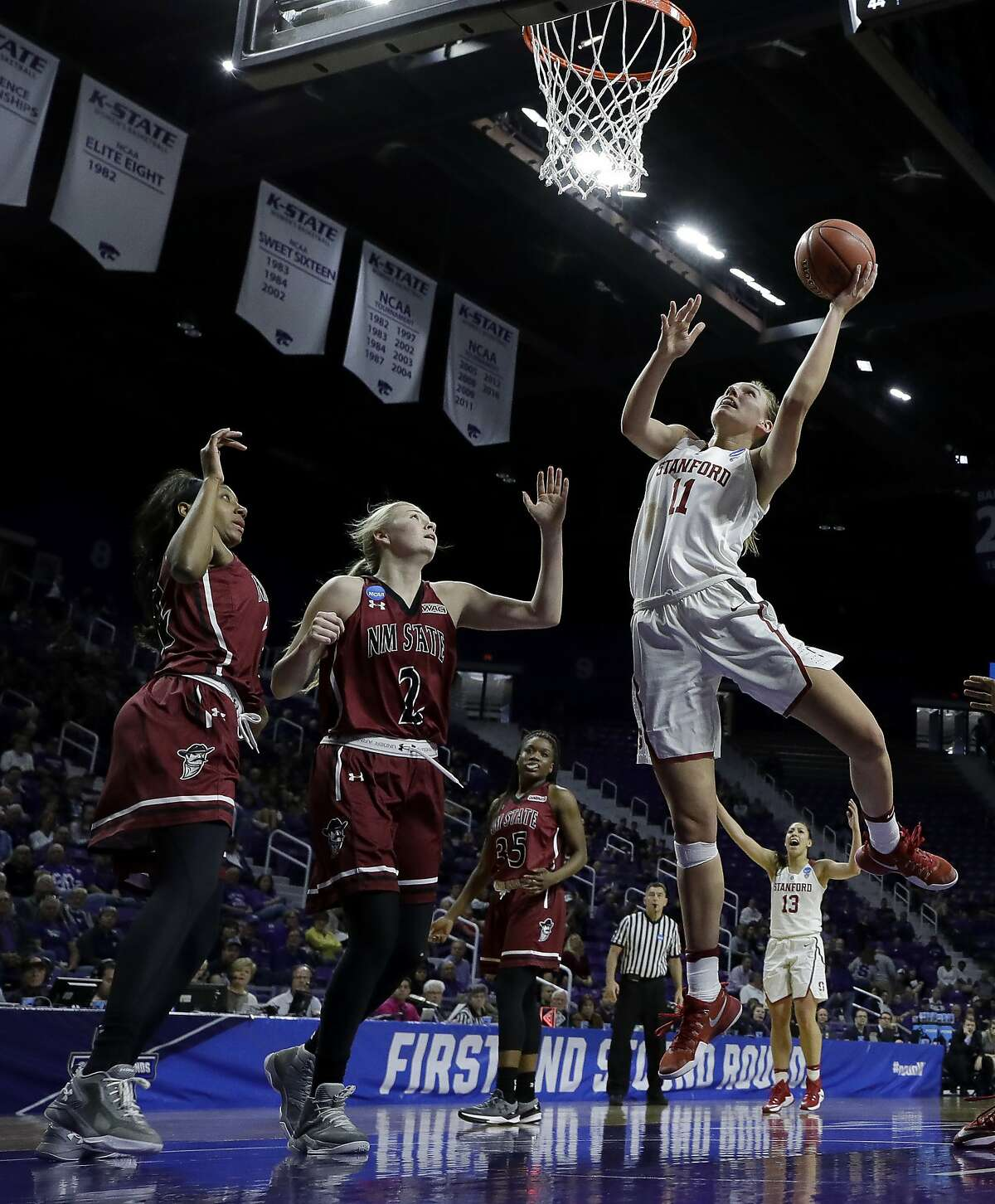 Stanford's Alanna Smith (11) gets past New Mexico State's Brooke Salas (2) to put up a shot during the second half of a first-round game in the NCAA women's college basketball tournament Saturday, March 18, 2017, in Manhattan, Kan. Stanford won 72-64. (AP Photo/Charlie Riedel)