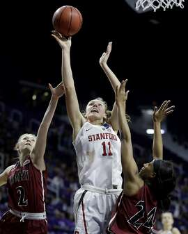 Stanford's Alanna Smith (11) gets past New Mexico State's Brooke Salas (2) and Brianna Freeman (24) to put up a shot during the second half of a first-round game in the NCAA women's college basketball tournament Saturday, March 18, 2017, in Manhattan, Kan. Stanford won 72-64. (AP Photo/Charlie Riedel)