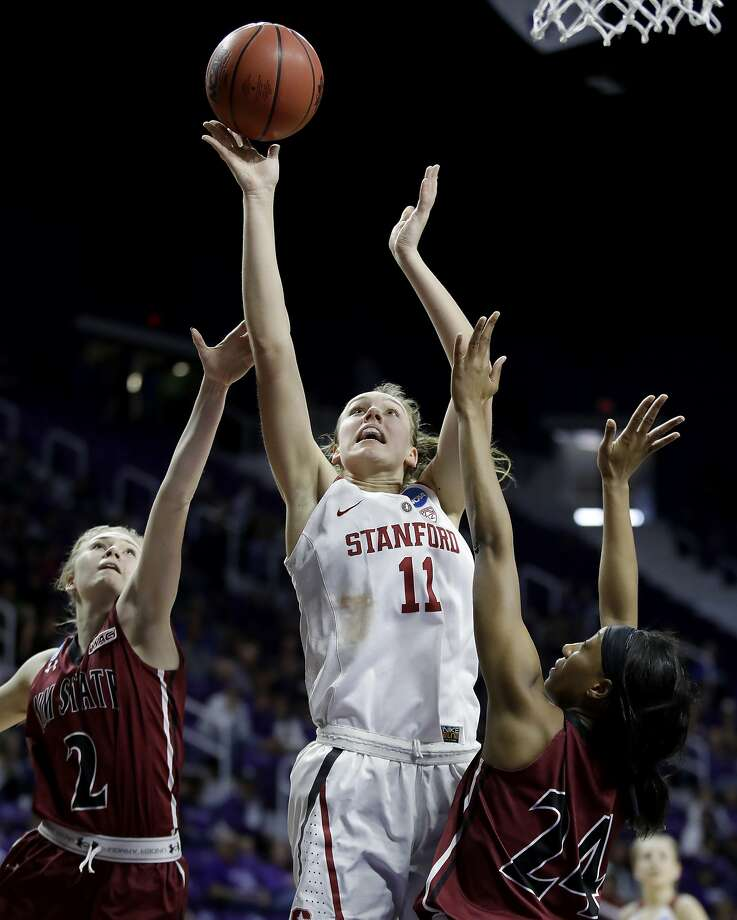 Stanford's Alanna Smith (11) gets past New Mexico State's Brooke Salas (2) and Brianna Freeman (24) to put up a shot during the second half of a first-round game in the NCAA women's college basketball tournament Saturday, March 18, 2017, in Manhattan, Kan. Stanford won 72-64. (AP Photo/Charlie Riedel) Photo: Charlie Riedel, Associated Press