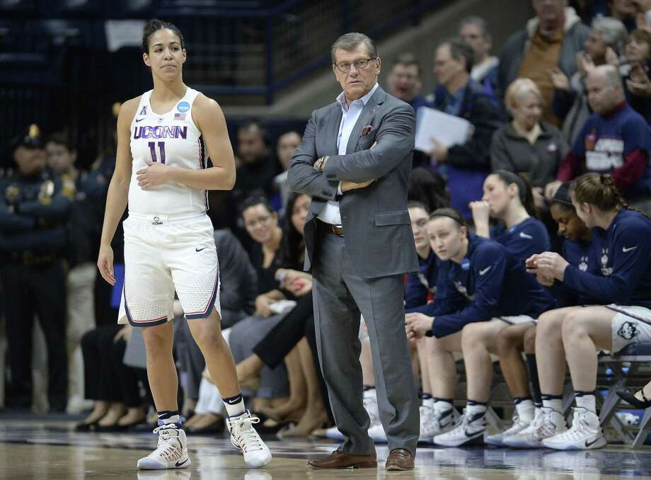 UConn's Kia Nurse, left, and coach Geno Auriemma watch the action during Saturday's NCAA tournament win over Albany. Photo: Jessica Hill / Associated Press / AP2017