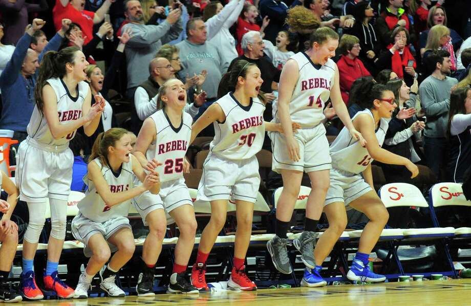 New Fairfield teammates leap off the bench to celebrate their win over Bacon Academy in Class M Girls Basketball Championship action at Mohegan Sun Arena in Montville, Conn., on Saturday Mar. 18, 2017. Photo: Christian Abraham / Hearst Connecticut Media / Connecticut Post