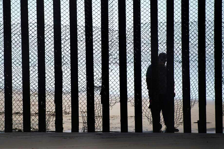 The current border fencing includes 15-foot steel posts set inches apart designed to keep people from crossing and shorter posts to block cars. Photo: JIM WATSON, Staff / AFP or licensors