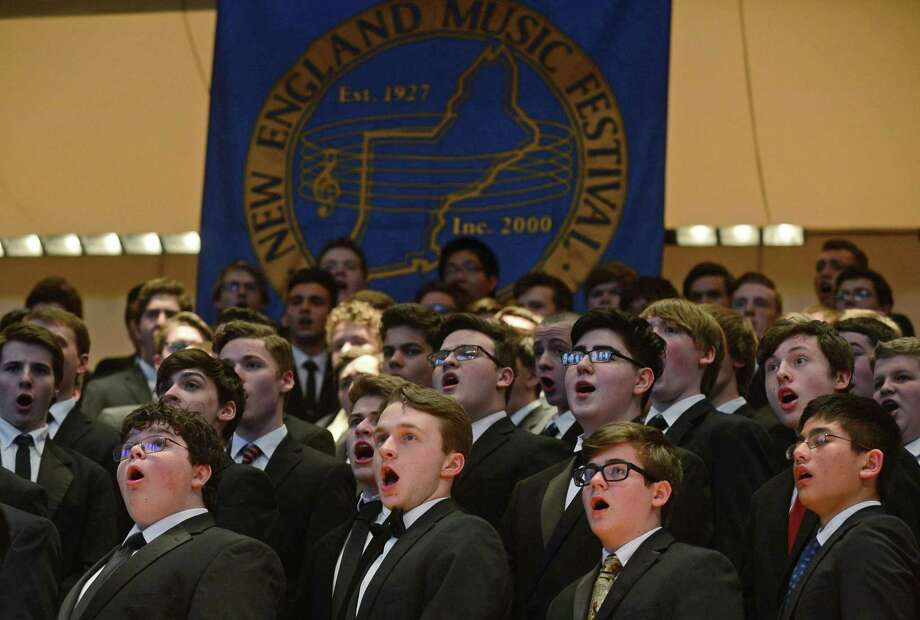 Brien McMahon High School student Anthony D'Andrea, second from left, sings with the chorus as 434 students from 86 high schools in all six New England states perform at Norwalk's City Hall Saturday, March 18, 2017, during the New England Music Festival in Norwalk, Conn. Photo: Erik Trautmann / Hearst Connecticut Media / Norwalk Hour