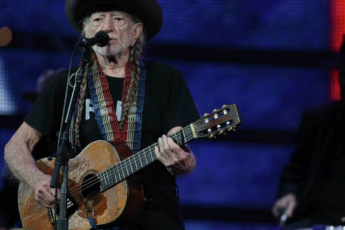 """Willie Nelson and his guitar """"Trigger"""" perform before a sold-out concert at RodeoHouston Saturday, March 18, 2017, in Houston."""