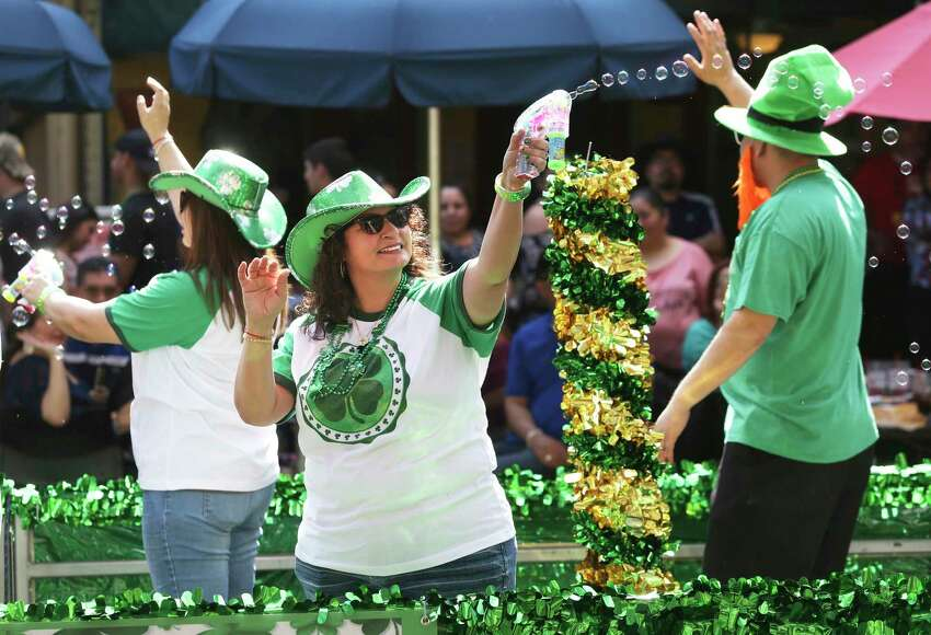 Bubbles aboard a float contribute to the festivities as St. Patrick's Day is celebrated on the Riverwalk with both the river and the beer dyed green for the occasion on March 18, 2017.