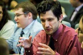 Jonathan Dearing, 29, networks during an event at Rice University on Saturday hosted by Houston Millennials, which intends to train young professionals and students to run for office.