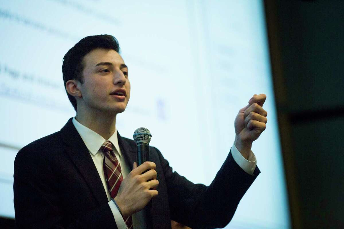 18-year-old Mike Floyd, a candidate for the Pearland ISD school board, talks  during a training called Millennials 4 Office 101.