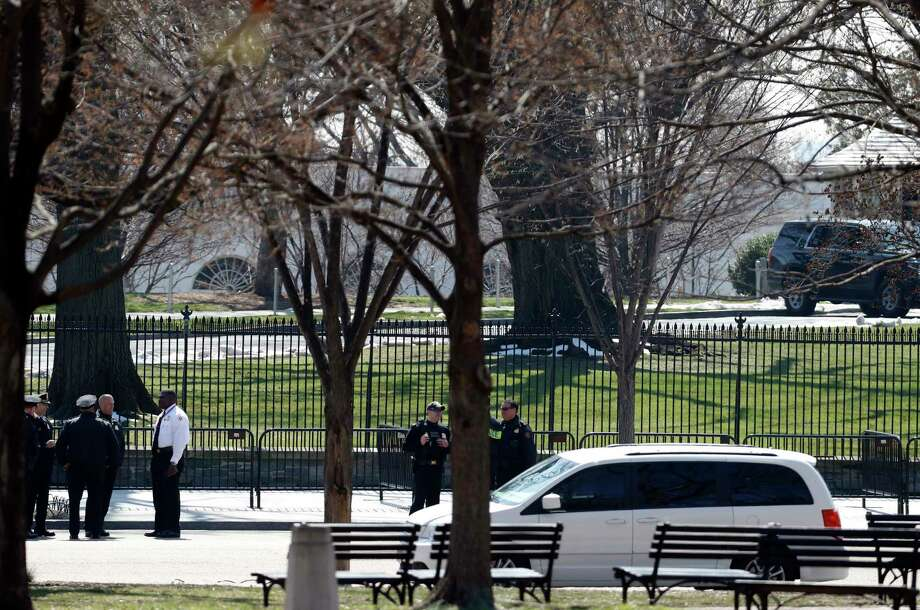 US Secret Service officers stand in the cordoned off area on Pennsylvania Avenue after a security incident near the fence of the White House in Washington, Saturday, March 18, 2017. President Trump was not at the White House at the time of the incident. (AP Photo/Alex Brandon) Photo: Alex Brandon, STF / Copyright 2017 The Associated Press. All rights reserved.