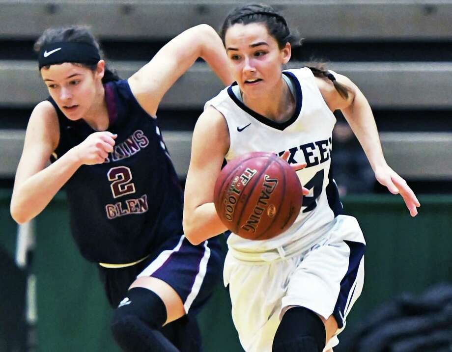 Mekeel Christian Academy's #14 Madison Show, right, runs past Watkins Glen's #2 Ryanna LaMoreaux during their Class C state semifinal game Saturday March 18, 2017 in Troy, NY.  (John Carl D'Annibale / Times Union) Photo: John Carl D'Annibale / 20039983A