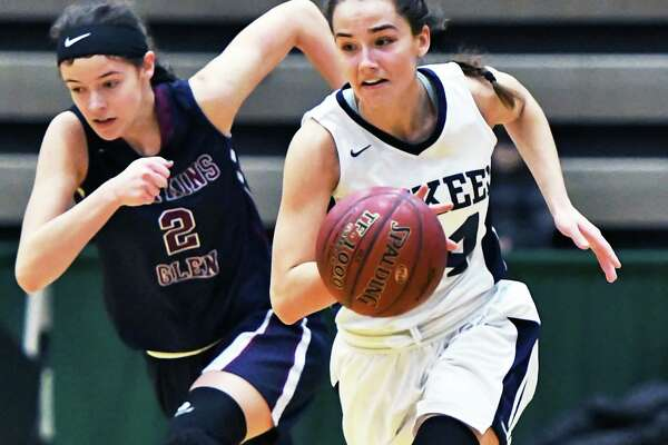 Mekeel Christian Academy's #14 Madison Show, right, runs past Watkins Glen's #2 Ryanna LaMoreaux during their Class C state semifinal game Saturday March 18, 2017 in Troy, NY.  (John Carl D'Annibale / Times Union)