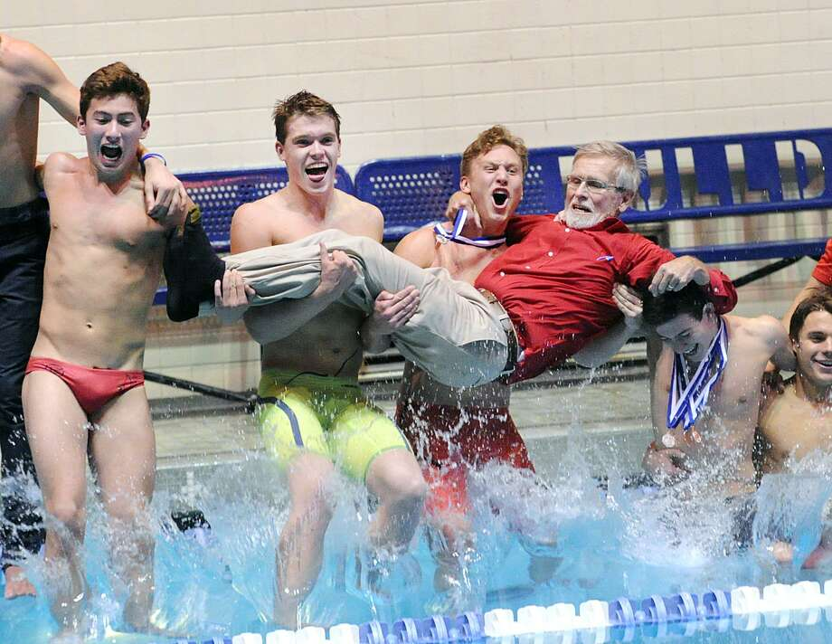 Greenwich swimmer Conrad Moss, center, screams as he and his teammates including Aedan Lewis, second from left, jump into the pool holding their coach, Terry Lowe, as they celebrated their victory in State Open Saturday at Yale University's Kiphuth Pool in New Haven. Greenwich won its fifth straight State Open title by six points. Photo: Bob Luckey Jr. / Hearst Connecticut Media / Greenwich Time