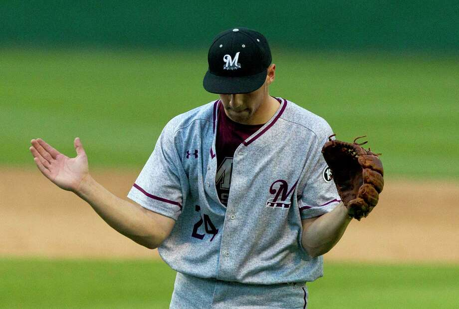 Magnolia starting pitcher Adam Kloffenstein (24) claps his hands after getting Eric Oakes #4 of Tomball to pop up to get out of a bases loaded jam to end the top of the first inning during a District 20-5A high school baseball game Thursday, March 16, 2017, in Tomball. Photo: Jason Fochtman, Staff Photographer / © 2017 Houston Chronicle