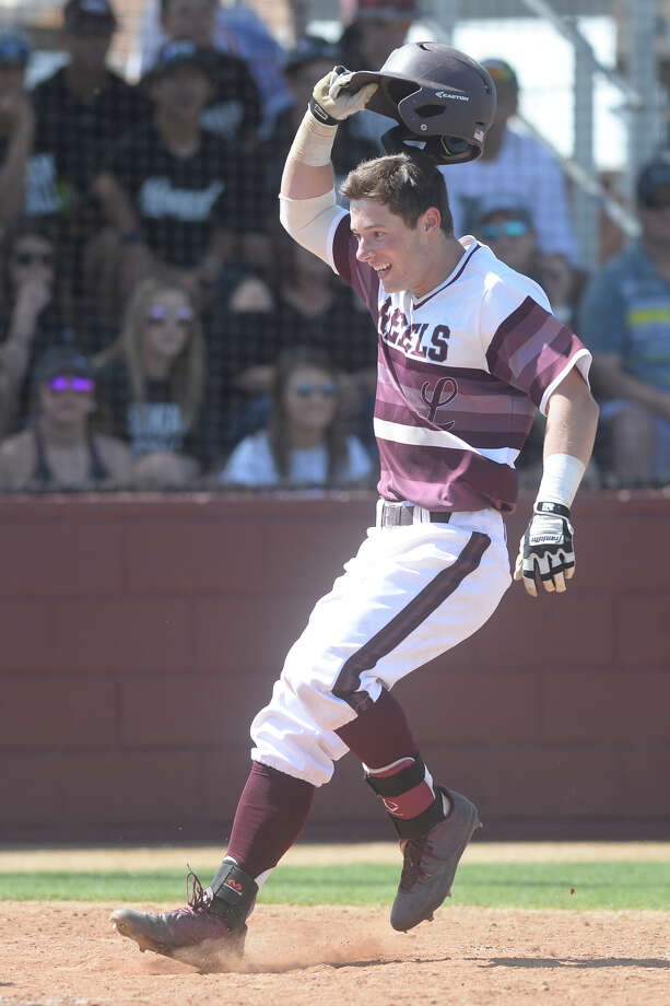Lee's John Wuthrich tags home after hitting a home run against Permian on March 18, 2017, at Ernie Johnson Field. James Durbin/Reporter-Telegram Photo: James Durbin