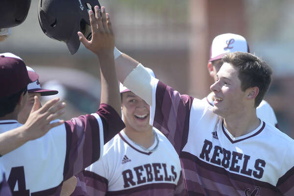 Lee's John Wuthrich is congratulated by teammates after hitting a home run against Permian on March 18, 2017, at Ernie Johnson Field. James Durbin/Reporter-Telegram