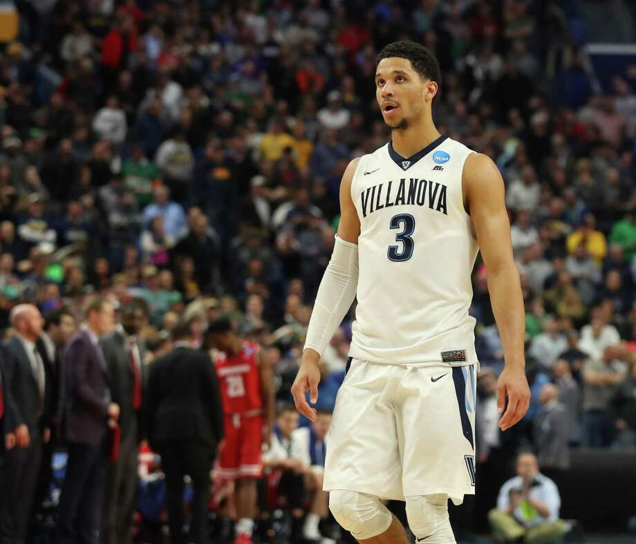 Villanova guard Josh Hart (3) checks the scoreboard in the closing seconds of their 65-62 loss to West Virginia in a second-round men's college basketball game against Wisconsin in the NCAA Tournament, Saturday, March 18, 2017, in Buffalo, N.Y. (AP Photo/Bill Wippert) Photo: Bill Wippert, FRE / Associated Press / FR170745 AP
