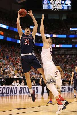 SALT LAKE CITY, UT - MARCH 18: Jock Landale #34 of the St. Mary's Gaels attempts a shot defended by Dusan Ristic #14 of the Arizona Wildcats during the second round of the 2017 NCAA Men's Basketball Tournament at Vivint Smart Home Arena on March 18, 2017 in Salt Lake City, Utah.  (Photo by Christian Petersen/Getty Images)