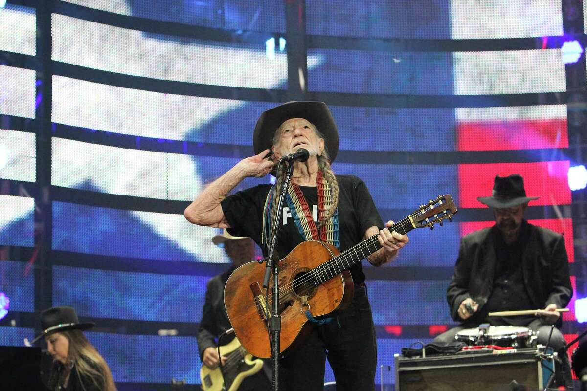 """A healthy and humourous Willie Nelson, and his guitar, """"Trigger,"""" perform before a sold-out concert at RodeoHouston on Saturday."""