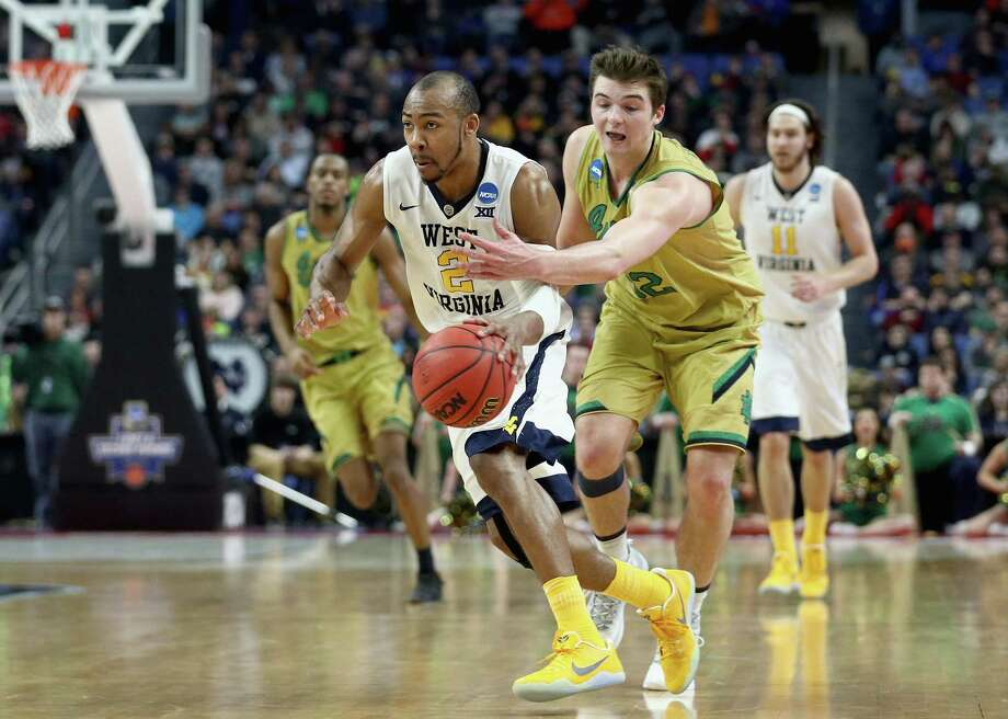 BUFFALO, NY - MARCH 18:  Steve Vasturia #32 of the Notre Dame Fighting Irish tries to stop Jevon Carter #2 of the West Virginia Mountaineers during the second round of the 2017 NCAA Men's Basketball Tournament at KeyBank Center on March 18, 2017 in Buffalo, New York.  (Photo by Maddie Meyer/Getty Images) ORG XMIT: 686514821 Photo: Maddie Meyer / 2017 Getty Images