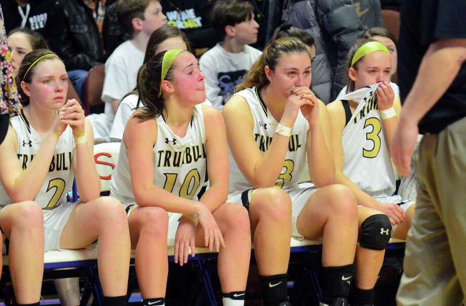 Trumbull teammates react after being defeated by New London in Class LL Girls Basketball Championship action at Mohegan Sun Arena in Montville, Conn., on Saturday Mar. 18, 2017. Photo: Christian Abraham / Hearst Connecticut Media / Connecticut Post