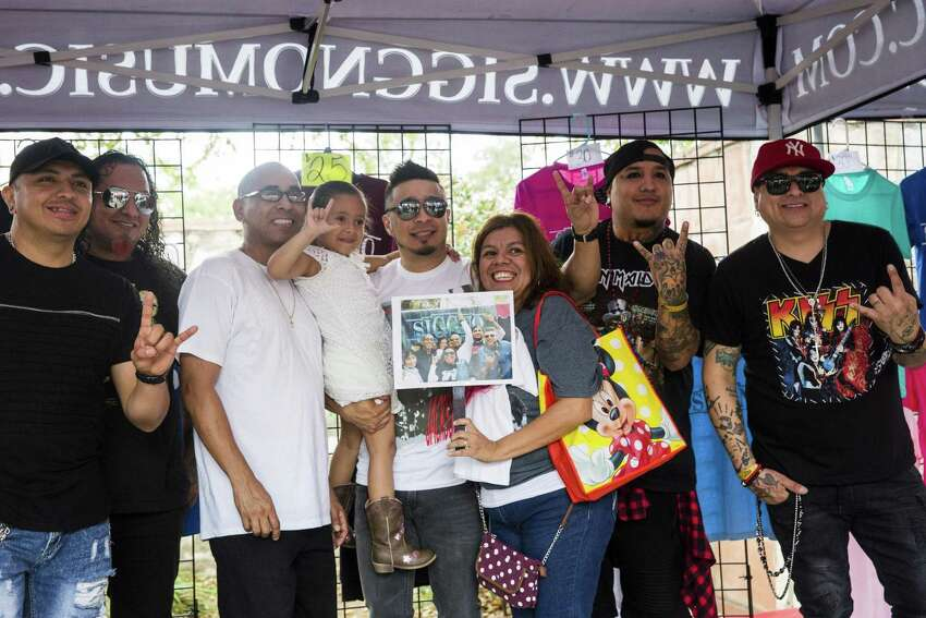 Elida Ortega, 4, and her father Victor, third to left, and Esperanza, third to right, pose with members of her favorite band, Siggno, at the Tejano Music Awards Fan Fair 2017 in San Antonio, Texas on March 18, 2017. Ray Whitehouse / for the San Antonio Express-News