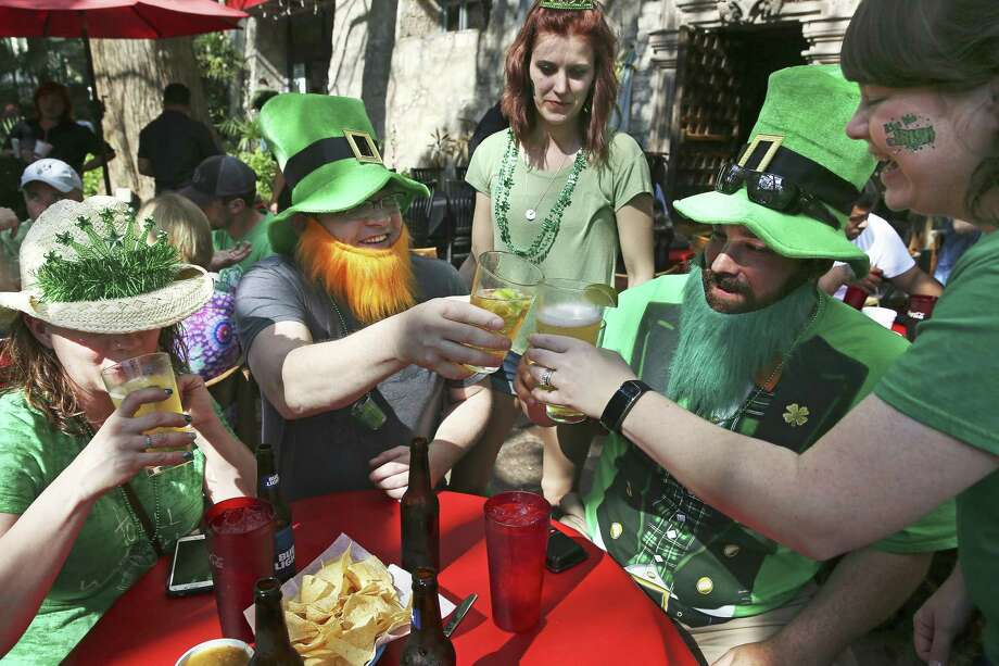 Visitors from Kansas celebrate St. Patrick's Day on the River Walk last year. But do they know how many signatories of the Declaration of Independence were of Irish descent? Photo: Tom Reel /San Antonio Express-News / 2017 SAN ANTONIO EXPRESS-NEWS