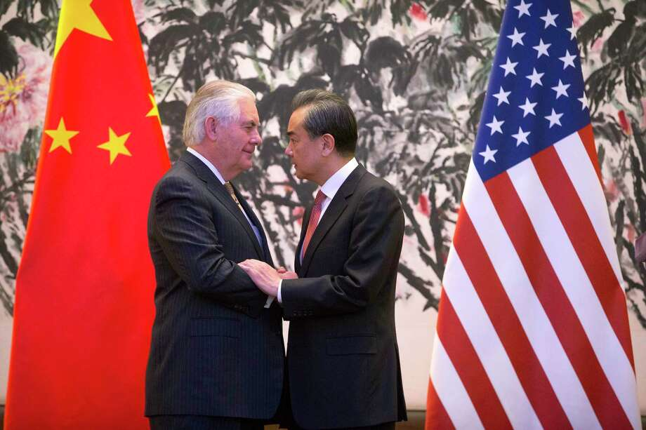 "Secretary of State Rex Tillerson, left, said Chinese Foreign Minister Wang Yi agreed on the need for a ""course correction"" on dealings with North Korea. Photo: Mark Schiefelbein, STF / AP POOL"