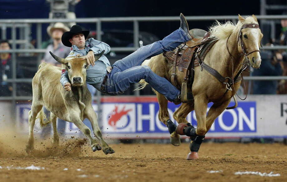 Tyler Waguespack competes during the championship round of the steer wrestling competition in the Super Series IV at the Houston Livestock Show and Rodeo at NRG Stadium, Saturday, March 12, 2016.  ( Karen Warren / Houston Chronicle ) Photo: Karen Warren, Staff / © 2016  Houston Chronicle