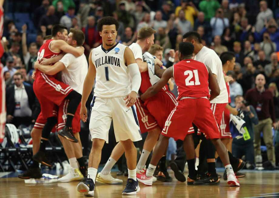 Villanova guard Jalen Brunson leaves the court in disbelief as Wisconsin players celebrate the end of their second-round upset. It marked the third defeat of a No. 1 seed for the Badgers in four years, after they beat Arizona in 2014 and Kentucky in 2015. Photo: Bill Wippert, FRE / FR170745 AP