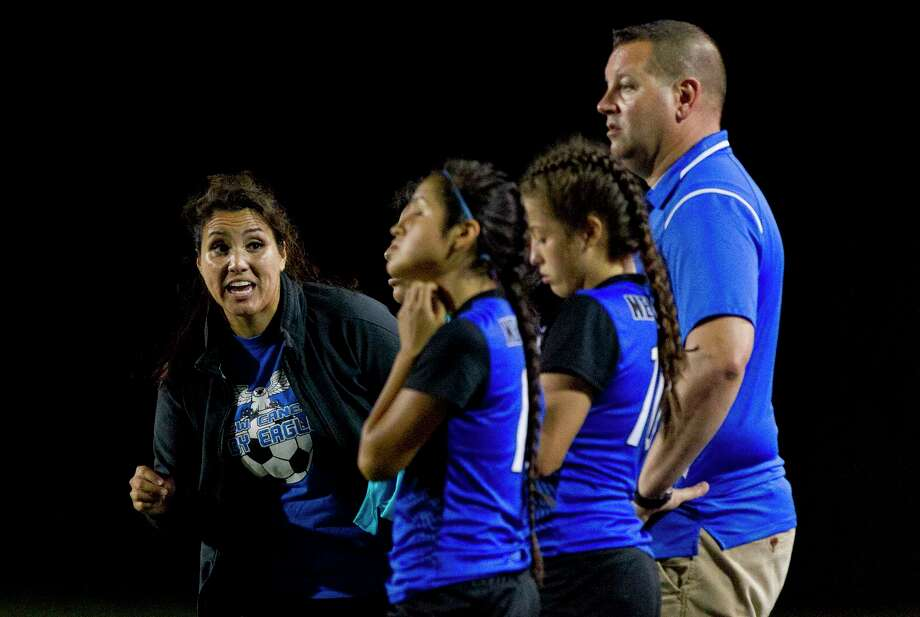 New Caney assistant coach Yolanda Johnston, left, instructs players along side her husband and head coach Michael during the first period of a District 20-5A high school girls soccer match at Texan Drive Stadium Tuesday, Feb. 28, 2017, in New Caney. Photo: Jason Fochtman, Staff Photographer / © 2017 Houston Chronicle