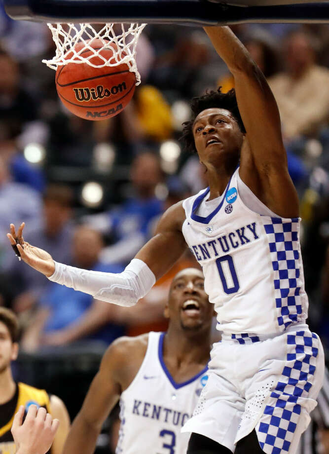 Kentucky's De'Aaron Fox (0) dunks during the second half of a first-round game against Northern Kentucky in the men's NCAA college basketball tournament Friday, March 17, 2017, in Indianapolis. Kentucky won 79-70. (AP Photo/Jeff Roberson)