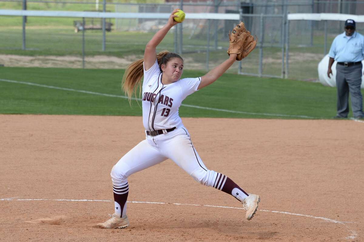Alana Noble (13) of Cinco Ranch delivers a pitch during the sixth inning of a varsity softball game between the Cinco Ranch Cougars and the Memorial Mustangs on Saturday March 18, 2017 at Cinco Ranch HS, Katy, TX.