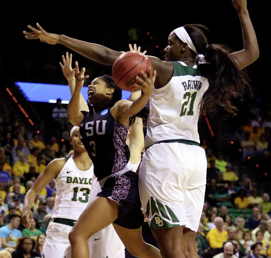 TSU's Joyce Kennerson (3) is fouled by Baylor's Kalani Brown (21) as she tries to score in the first half. The going was tough all day for the Tigers, whose 89-point margin of defeat set a women's Tournament record. Photo: Jerry Larson, FRE / FR91203AP