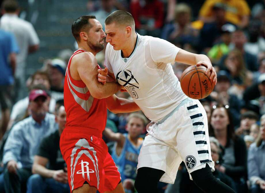 Denver Nuggets forward Nikola Jokic, right, of Serbia, rams into Houston Rockets forward Ryan Anderson and draws a foul in the first half of an NBA basketball game Saturday, March 18, 2017, in Denver. (AP Photo/David Zalubowski) Photo: David Zalubowski, STF / Copyright 2017 The Associated Press. All rights reserved.