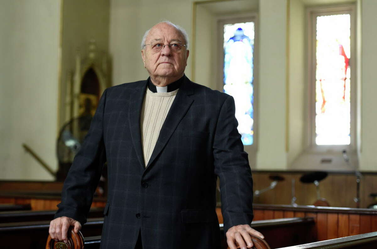 Father Peter Young in the sanctuary of the Mother Teresa Community Church in Albany, N.Y. In a meeting last year, a state employee gave Young a tongue lashing that shocked his supporters. (Skip Dickstein/Times Union)